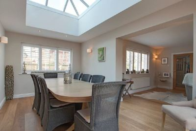 Photo of stunning new interior after renovation - open plan with roof lights