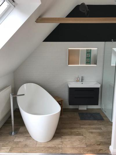 Photo shows loft conversion with modern bathroom suite